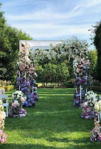 park wedding violet flower arch rachelaclingen