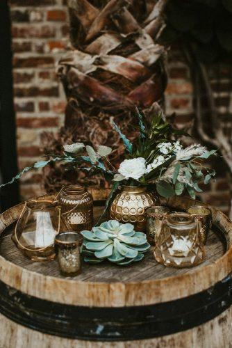 sage green wedding recetion decorations details with white fresh flowers and greenery on wine barrel vicky baumann
