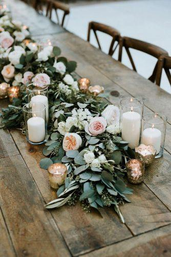 sage green wedding tablerunner with candles and greenery pink and peach roses mark trela photography