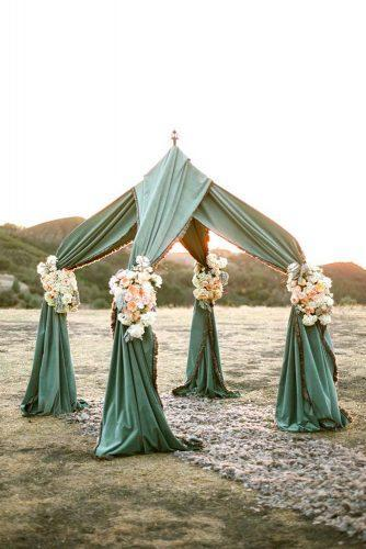sage green wedding cloth arch with flowers outdoor ceremony aaron delesie