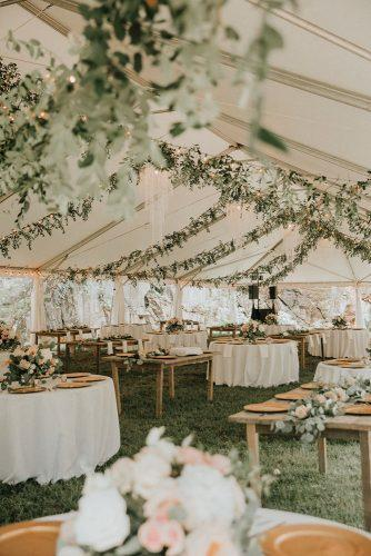 sage green wedding recetion under elegant white tent with greenery t&k photography