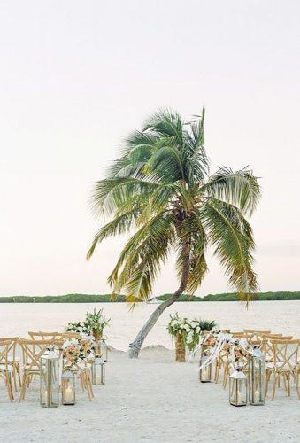 outdoor wedding venues aisle with palm Natalie Watson Photography