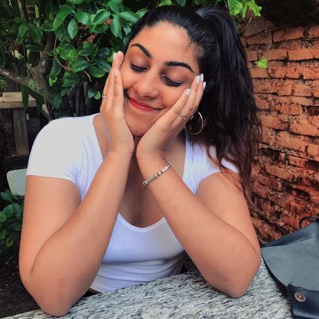 Image may contain: Mahika Panditha, smiling, sitting and outdoor