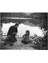 Image: Boris Karloff as Frankenstein Holding Flower by Little Girl 8 x 10 Inch Photo