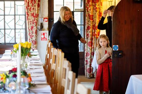 a flowergirl checks out the dining room