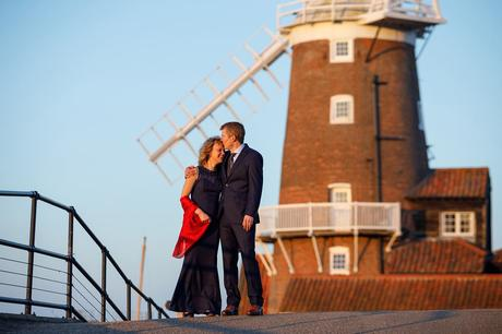 kissing with cley windmill in the background