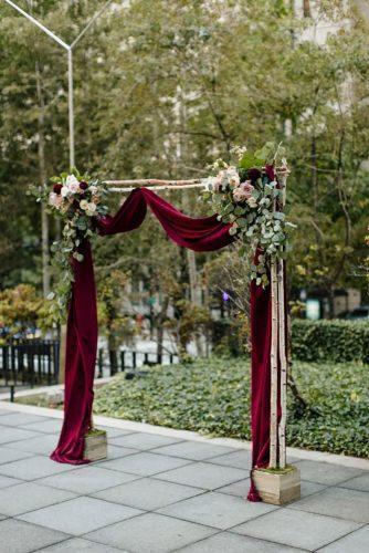 velvet wedding decor marsala velvet arch Abellera Photography