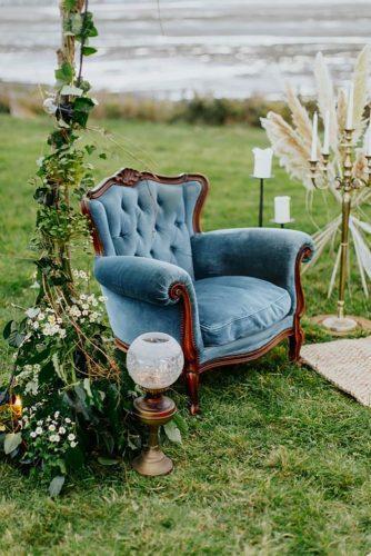velvet wedding decor blue chair Tara Statton Photography