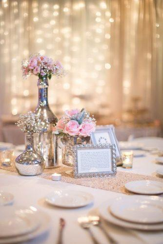silver wedding decor ideas centerpieces in silver vases bottles and pink roses amy & jordan photography