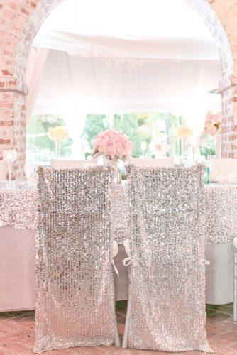 silver wedding decor ideas reception with sparkle tablecloth and chairs pink roses on table amalie orrange