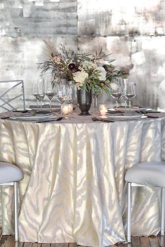 silver wedding decor ideas on round table atlas tablecloth tall vase with flowers bbjlinen