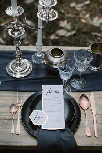 silver wedding decor ideas table with dark dishes and tablerunners mlk photography