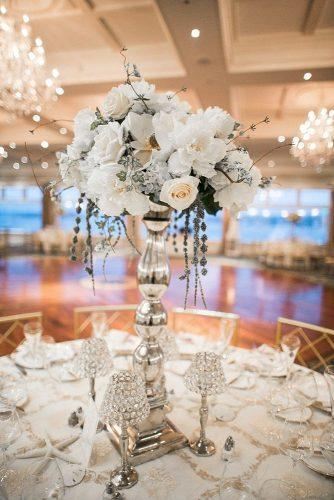 silver wedding decor ideas tall centerpiece with white flowers vintage jamie bodo photography