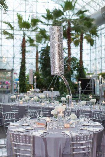 silver wedding decor ideas reception in monochrome gray tones with hanging centerpiece miller + miller wedding photography