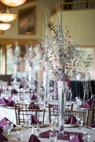 silver wedding decor ideas tall centerpiece in vase with orchids and brunches the larken photo & video co