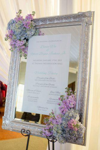 silver wedding decor ideas signs with mirror and vintage frame pastel lilac blue flowers theo milo photography