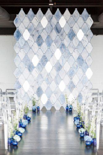 silver wedding decor ideas blue backdrop with flower aisle cassi claire