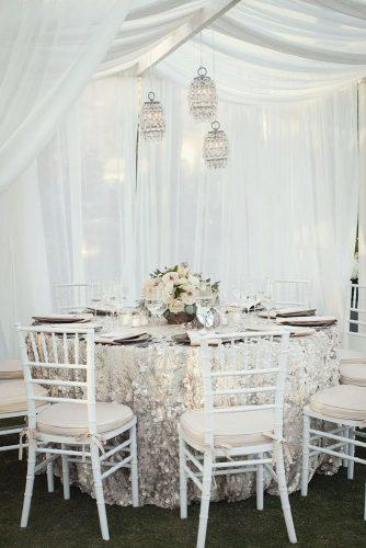 silver wedding decor ideas round table with sparkle tablecloth and flowers ashleigh taylor photography