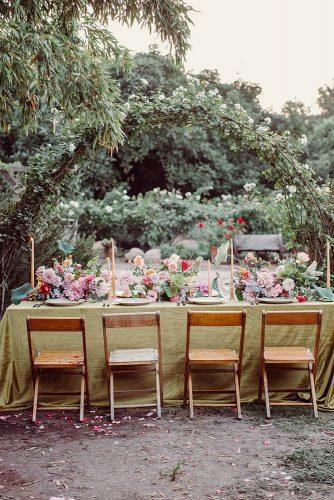summer wedding trends outdoor table long with greenery tablecloth and natural bright flowers jonachristinaphoto