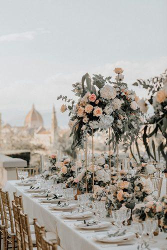 summer wedding trends peachy roses in tall wedding centerpieces with greenery john david weddings