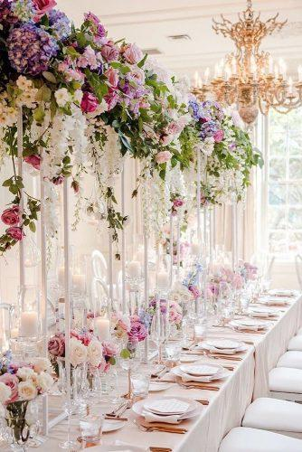 summer wedding trends tall with bright cascading flowers on all white reception agistudio