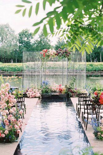 summer wedding trends outdoor wedding ceremony with bright flowers and mirror aisle elenapavlovaphoto