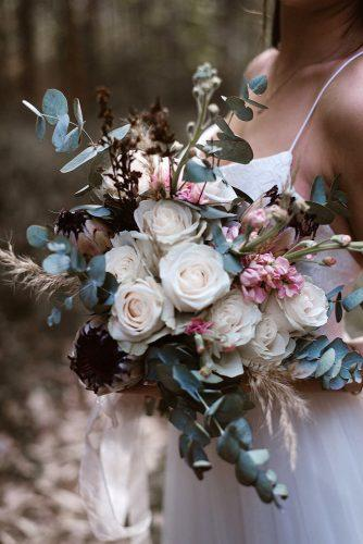 summer wedding trends bridal bouquet with white roses and seeds and greenery mlk photography