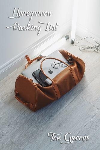 honeymoon packing list casual luggage with smartphone and notebook