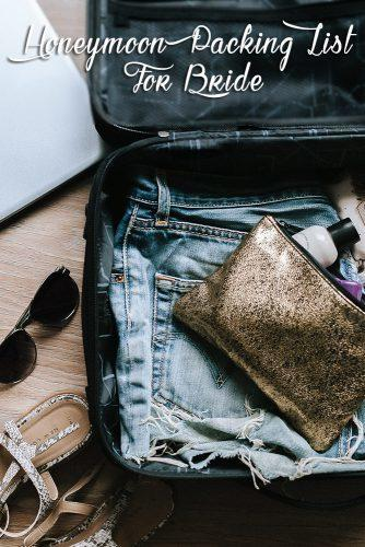 honeymoon packing list luggage with clothes and other items