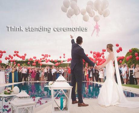wedding on a budget standing ceremony bride and groom with guests and balloons