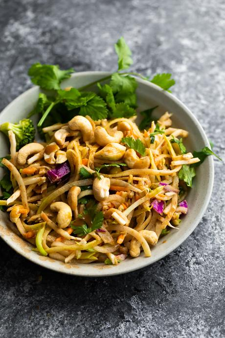 thai salad in bowl with cashews and fresh cilantro