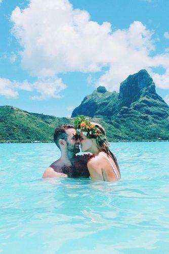 wedding splurges romantic couple in the water honeymoon