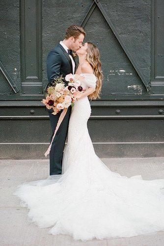 wedding splurges bride and groom kiss reception