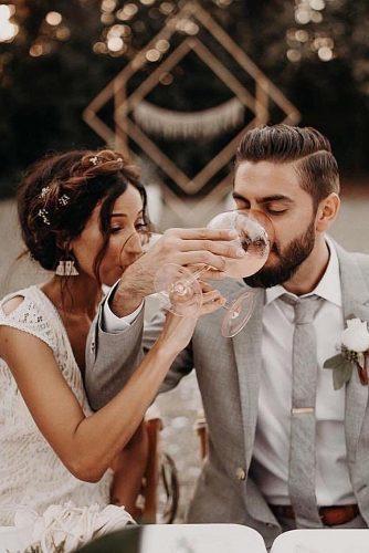 wedding splurges drinking wine reception