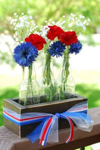 independence-day-wedding-4th-of-july-centerpiece-in-wooden-crates-with-flowers-and-blue-white-red-ribbons-creationsbykara