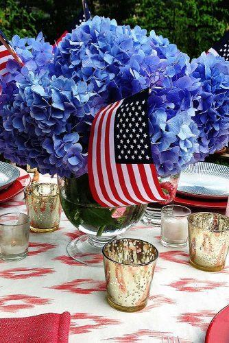 independence day wedding 4th of july centerpiece with blue flowers and american flags danielledrollins
