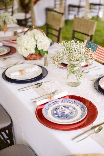 independence day wedding 4th of july rustic reception table red white and blue colors with baby breath ashley + david photography