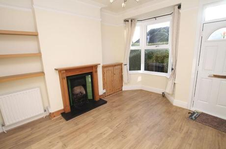 Before shot of Victorian living room.
