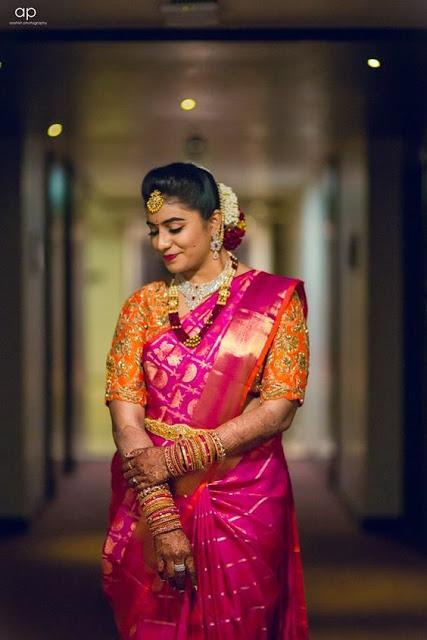 Pink Wedding Saree and Orange Blouse