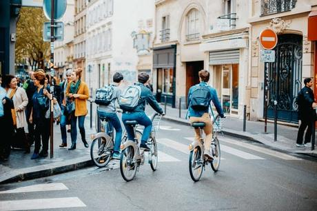 photo-of-people-riding-bicycle-on-street