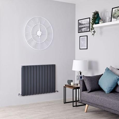 Milano Alpha designer radiator in a gray living room.