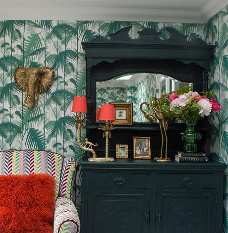 Green living room inspiration with tropical patterned wallpaper