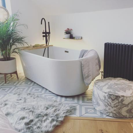 Freestanding bath and a Milano Windsor radiator.