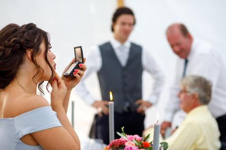a bridesmaid touches up her makeup