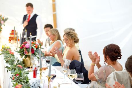 the mother of the bride applauds the groom
