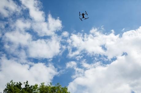 a drone taking photos of the wedding guests