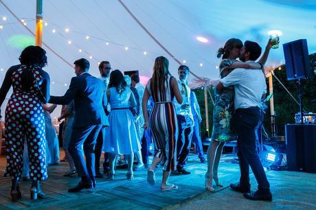 a couple kiss on the dancefloor