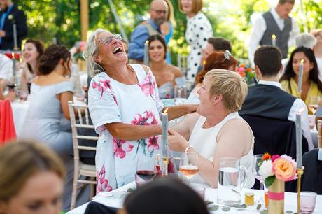 tow wedding guests share a joke