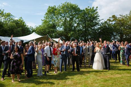 guests assemble to wave at a drone