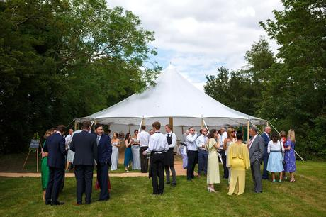 guests outside the wedding marquee